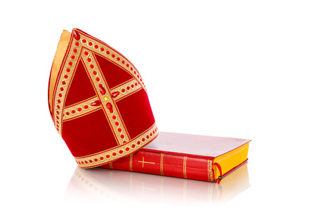 nicolaas: Mitre or mijter and book of Sinterklaas. Isolated on white backgroud. Part of a dutch sancta tradition Stock Photo