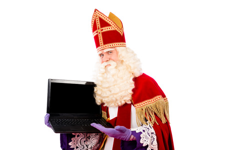 nicolaas: Sinterklaas with laptop. isolated on white background. Dutch character of Santa Claus