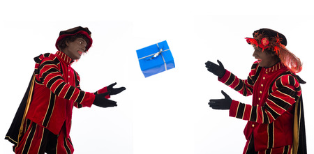 zwarte pieten ( black pete)  with gift . typical Dutch character part of a traditional event celebrating the birthday of Sinterklaas (Santa Claus) in december