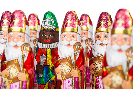 'black pete': Close-up of Sinterklaas and Black Pete . Saint  Nicholas chocolate figure of  Dutch character of Santa Claus.Isolated on white background.