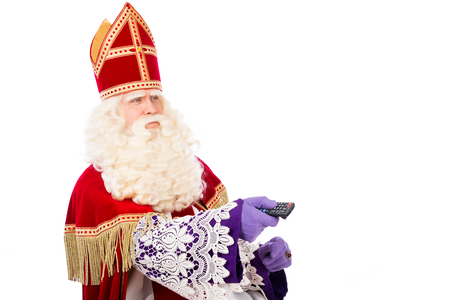 nicolaas: Sinterklaas with TV remote . isolated on white background. Dutch character of Santa Claus Stock Photo