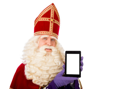 sint nicolaas: Sinterklaas with tablet. isolated on white background. Dutch character of Santa Claus