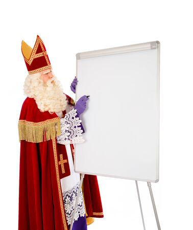 nicolaas: Sinterklaas writing on blank whiteboard. isolated on white background. Dutch character of Santa Claus