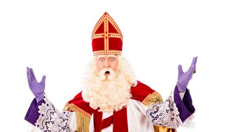 Sinterklaas naar beneden te kijken met de handen omhoog. geïsoleerd op een witte achtergrond. Nederlandse karakter van de Kerstman Stockfoto - 44127079