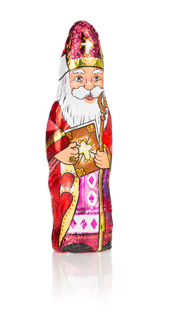 nicolas: Close up of Sinterklaas. Saint  Nicholas chocolate figure of  Dutch character of Santa Claus.Isolated on white background with reflection Stock Photo