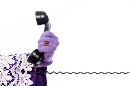 nicolaas: Hand of Sinterklaas with old vintage telephone. isolated on white background. Dutch character of Santa Claus Stock Photo
