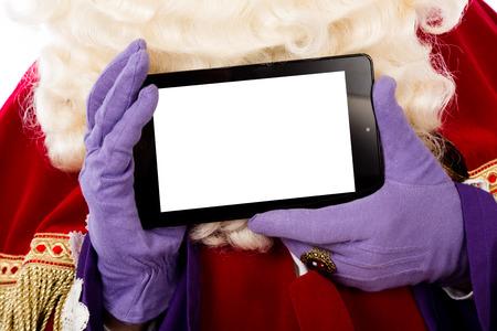 Sinterklaas met tablet. geïsoleerd op een witte achtergrond. Nederlandse karakter van de Kerstman