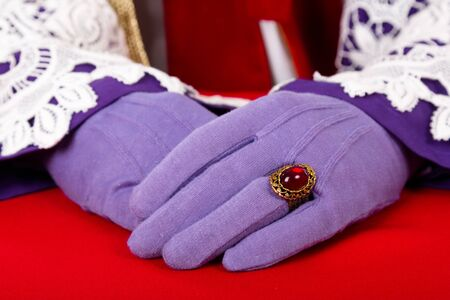 zwarte: close up of hands of Sinterklaas with purple gloves and ring