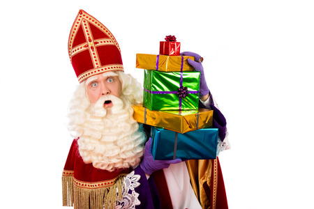 sinterklaas  with gifts . typical Dutch character part of a traditional event celebrating the birthday of Sinterklaas (Santa Claus) in december. 스톡 콘텐츠