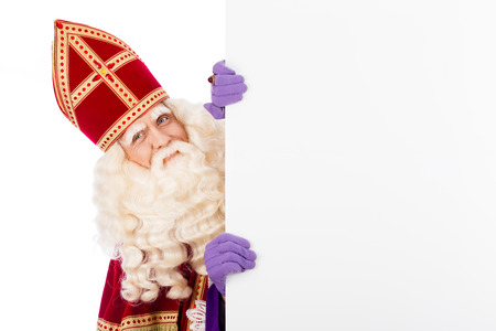 nicolaas: Sinterklaas with white cardboard. isolated on white background. Dutch character of Santa Claus