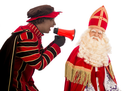 zwarte: zwarte piet ( black pete) is shouting to sinterklaas . typical Dutch character part of a traditional event celebrating the birthday of Sinterklaas (Santa Claus) in december