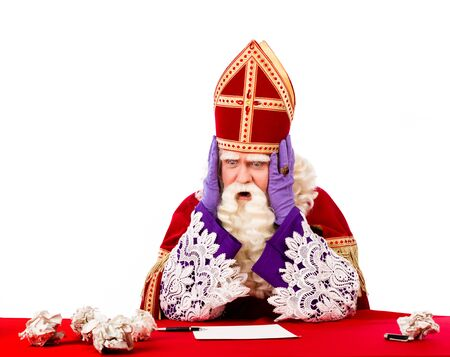 sinterklaas: Desperate sinterklaas not knowing what to do . typical Dutch character part of a traditional event celebrating the birthday of Sinterklaas (Santa Claus) in december Stock Photo