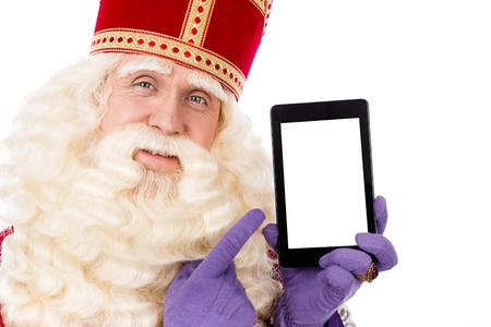 st. Nicholas met slimme telefoon of tablet.