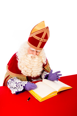 nicolaas: Sinterklaas with book . isolated on white background. Dutch character of Santa Claus