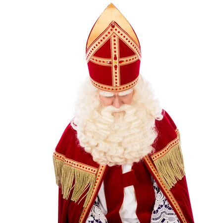 nicolaas: Sinterklaas looking down. isolated on white background. Dutch character of St. Nicholas