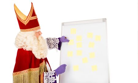 nicolaas: Sinterklaas with yellow notes on whiteboard. isolated on white background. Dutch character of St. Nicholas