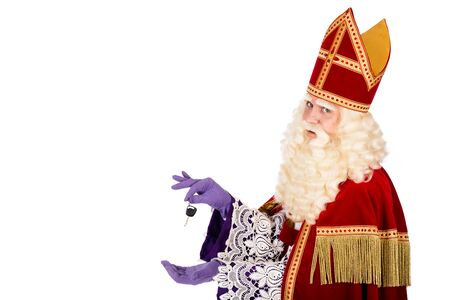 nicolaas: Sinterklaaswith Car Key. isolated on white background. Dutch character of St. Nicholas and Black Pete Stock Photo