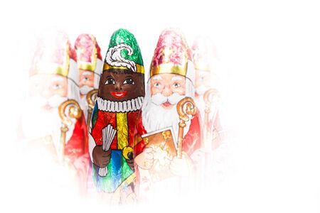 zwarte piet: Close up of Zwarte Piet. Black Pete chocolate figure of  Dutch character of Santa Claus.Isolated on white background.