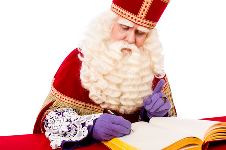 zwarte: Sinterklaas with book . isolated on white background. Dutch character of Santa Claus