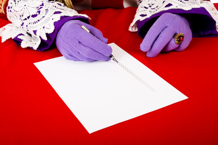 nicolaas: Hands of sinterklaas with empty check list. Isolated on white background. focus on hand