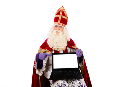 zwarte: Sinterklaas with laptop. isolated on white background. Dutch character of Santa Claus