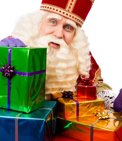 nicolaas: Sinterklaas with gifts . typical Dutch characterof st.Nicolaas and Zwarte Piet Stock Photo