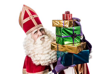 zwarte piet: Sinterklaas with gifts .  Vintage editing typical Dutch characterof st. Nicholas and Zwarte Piet