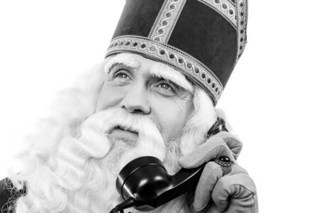 nicolaas: Sinterklaas with old  telephone.Monochrome. isolated on white background. Dutch character of Santa Claus Stock Photo