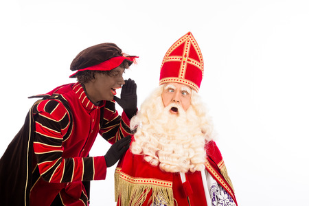 zwarte piet ( black pete) is shouting to sinterklaas . typical Dutch character part of a traditional event celebrating the birthday of Sinterklaas (Santa Claus) in december