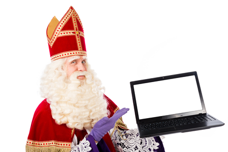 Sinterklaas with laptop. isolated on white background. Dutch character of Santa Claus