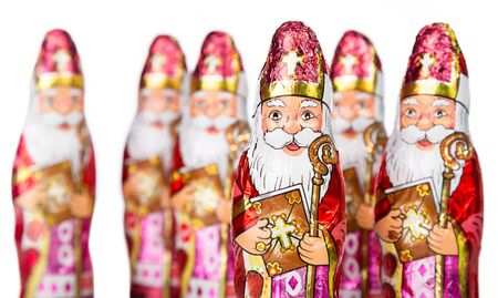 nicolaas: Close up of Sinterklaas. Saint  Nicholas chocolate figure of  Dutch character of Santa Claus.Isolated on white background.