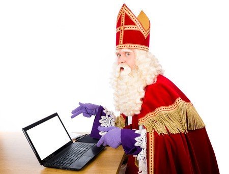 nicolaas: Sinterklaas with notebook. isolated on white background. Dutch character of Santa Claus