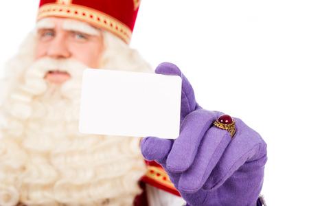 Sinterklaas met visitekaartje. geïsoleerd op een witte achtergrond. Nederlandse karakter van de Kerstman Stockfoto