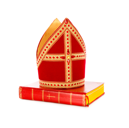 Mitre or mijter and book of Sinterklaas. Isolated on white backgroud. Part of a dutch santa tradition 스톡 콘텐츠