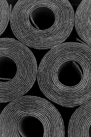 ruberoid: Closeup of Rolls of new black roofing felt or bitumen