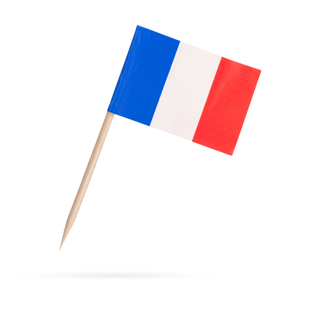 toothpick: Miniature paper flag France. Isolated French flag pointer on white background. With shadow below