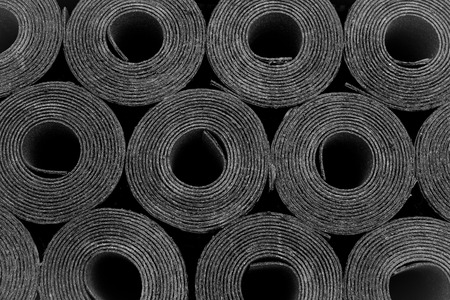 bitumen felt: Closeup of Rolls of new black roofing felt or bitumen