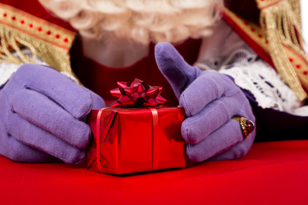 Sinterklaas with gift . typical Dutch character part of a traditional event celebrating the birthday of st.Nicolaas (Santa Claus) in december.