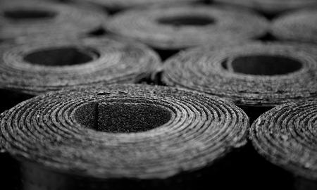 roofing membrane: Closeup of Rolls of new black roofing felt or bitumen. Selective focus