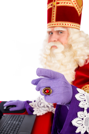 sint nicolaas: Sinterklaas with laptop. isolated on white background. Dutch character of Santa Claus. selective focus