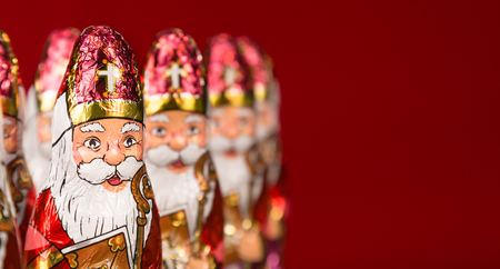 Close-up of Sinterklaas. Saint  Nicholas chocolate figurine of  Dutch character of Santa Claus. With copy space.