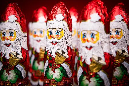 saint nicolas: Closeup of Santa Claus chocolate figurine on red background