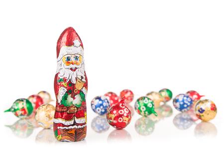 santaclaus: Closeup of Santa Claus chocolate figurine isolated on white background