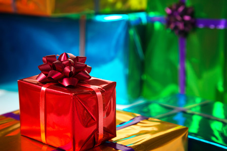 nicolaas: colorful and shiny gift boxes . Focus on red bow.