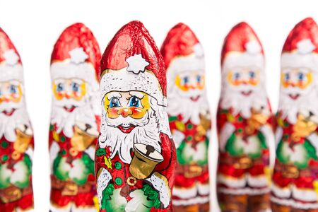 Closeup of Santa Claus chocolate figurine .Isolated on a white background Stockfoto