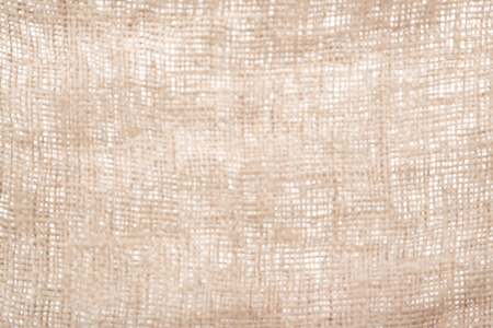 blurred burlap or jute open woven texture background. Defocussed.