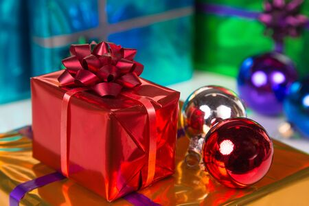 colorful gift boxes with xmas ornaments