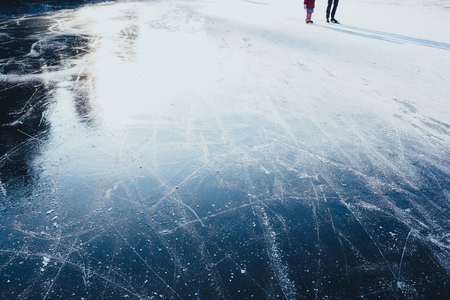 Surface of outdoor ice with skaters, replete with skate marks. Ice background Stockfoto