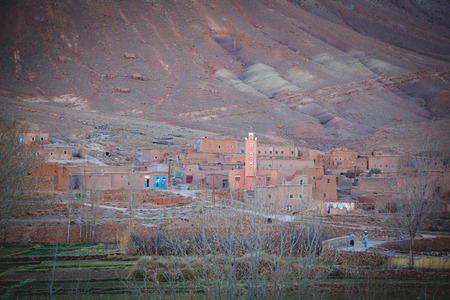 Small village with mosque in the High Atlas Mountains  in Morocco. Vintage editing