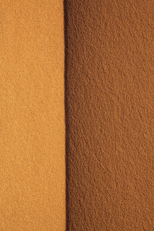 Background texture of desert sand.Top of real sand dune at sunset in Sahara desert Merzouga